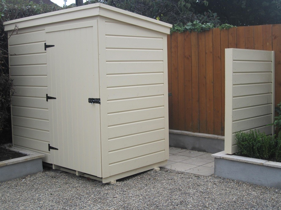 Baumanns bike shed with paved area behind for bins