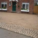 Gravel and granite apron driveway