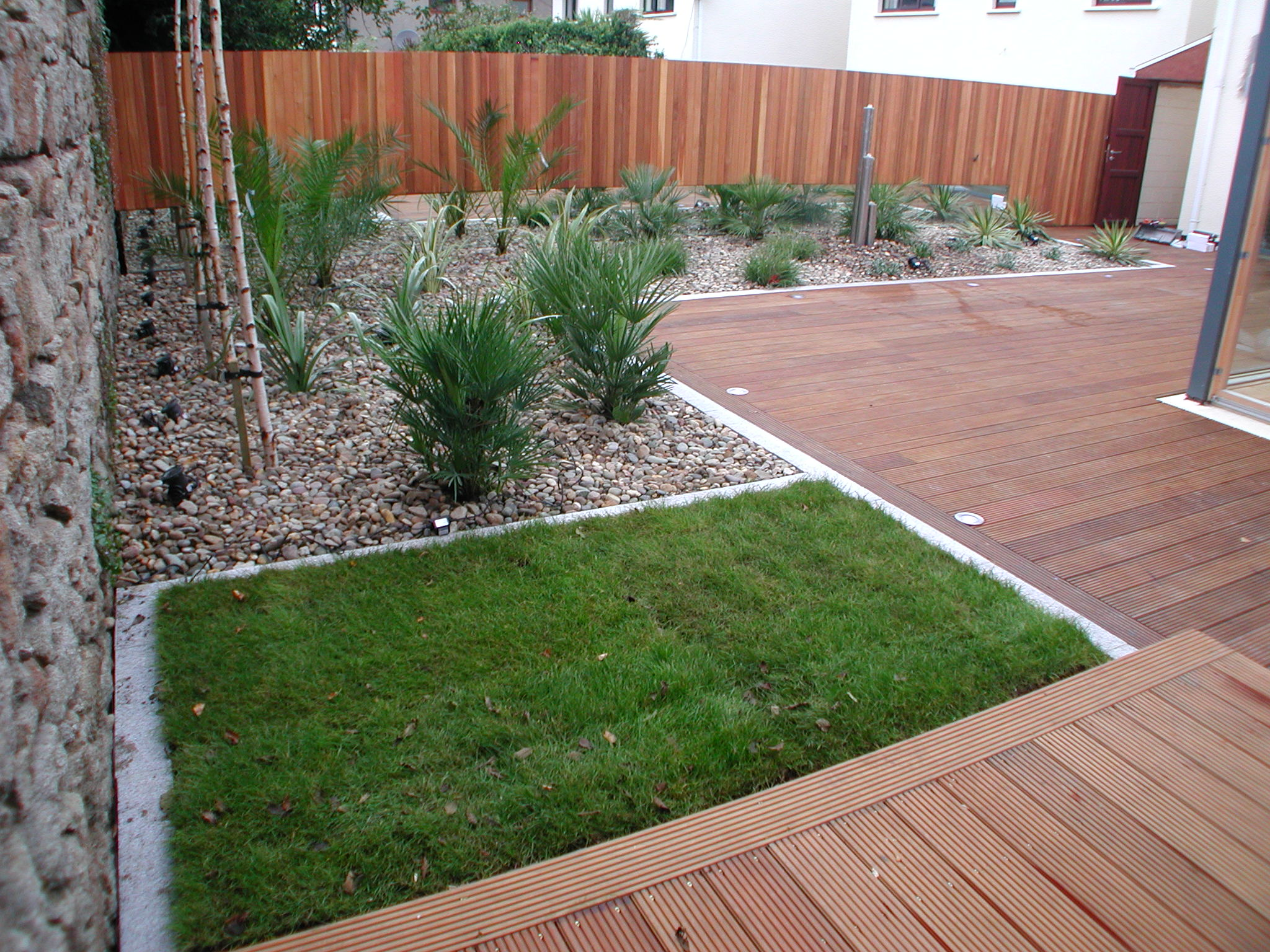 Decking with grass area in galloping green dublin for Garden ideas with decking and grass