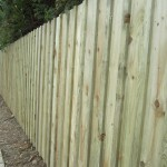 Vertical pressure treated spruce fencing