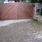 Granite pillars/apron and timber electric gates