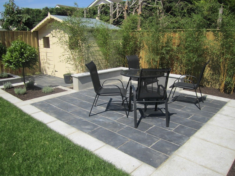 Black limestone seating area bordered by silver granite creating nice contrast