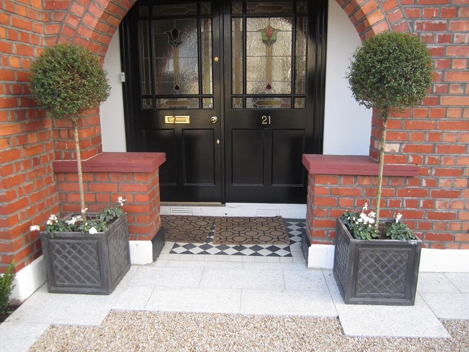 Front door framed with two Privet lollipops