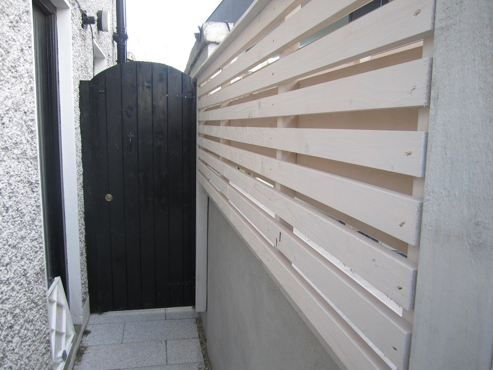 New side gate to create utility area behind