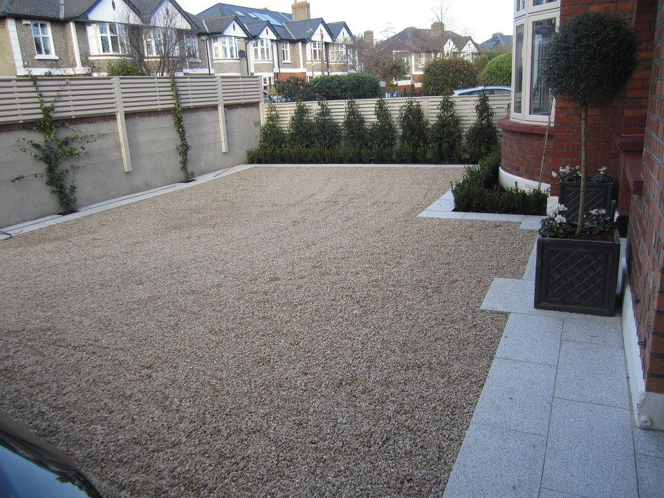 Stepped granite apron in front of house