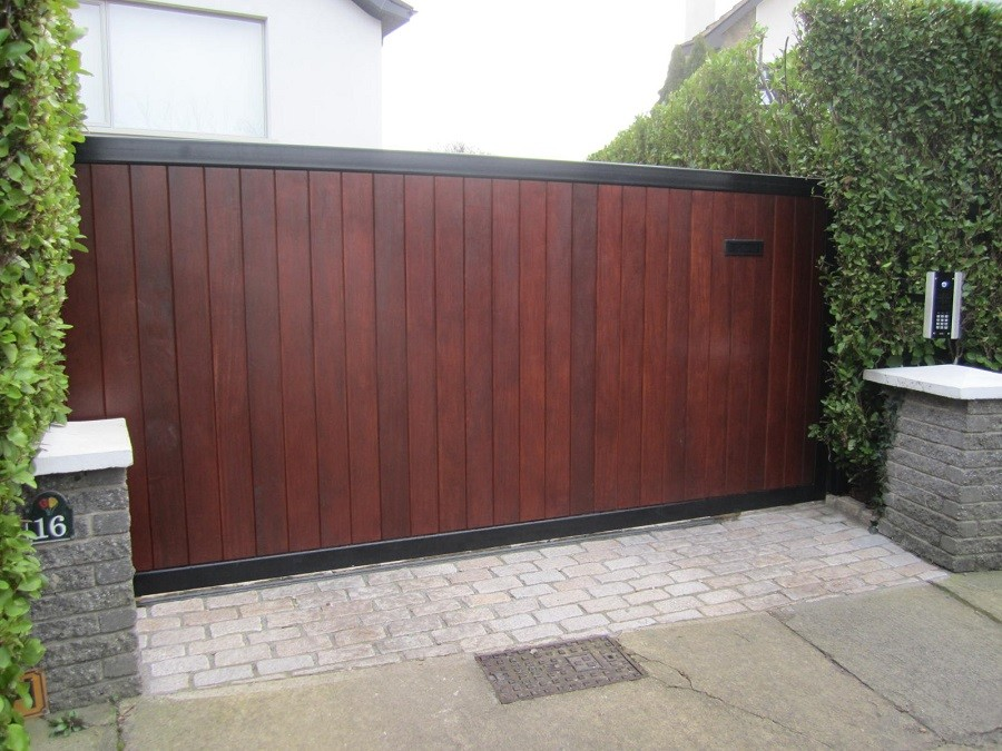Electric gate finished in Iroko