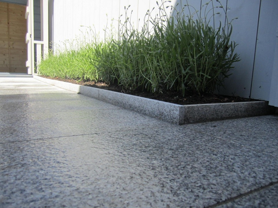 Raised edge created using granite cut offs