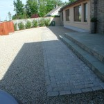 Gravel driveway and granite path