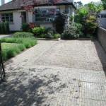 Cobblelock and gravel driveway
