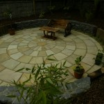 Indian sandstone circle and raised beds