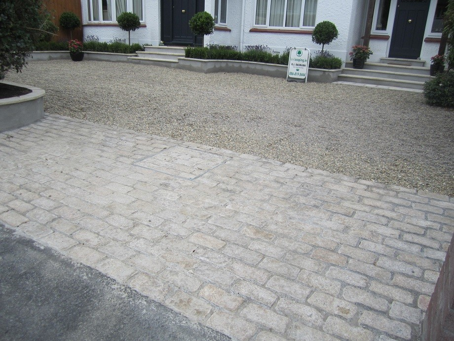 Cobble apron and disguised man hole