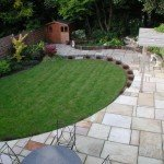 Mixed sized Indian sandstone patio