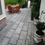 Silver granite slab and cobble patio