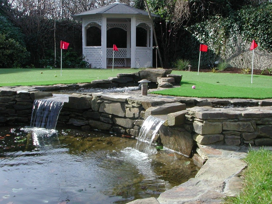 Pond, raised golf green and arbour