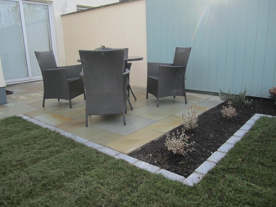 Extended limestone patio