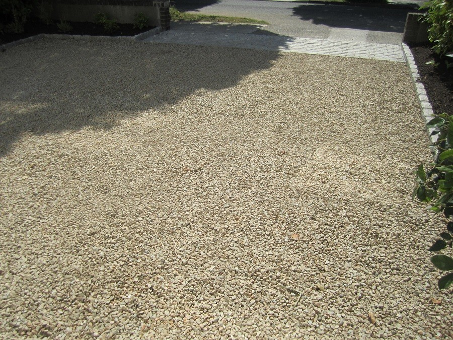 Concrete slab removed and replaced with warm textured Ballylusk gravel