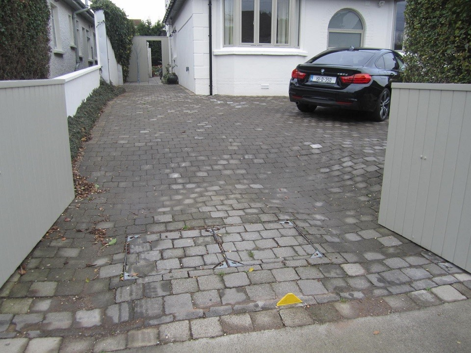 Old cobble driveway with two recessed man holes