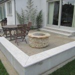 Granite seat, fire pit and black stemmed bamboo