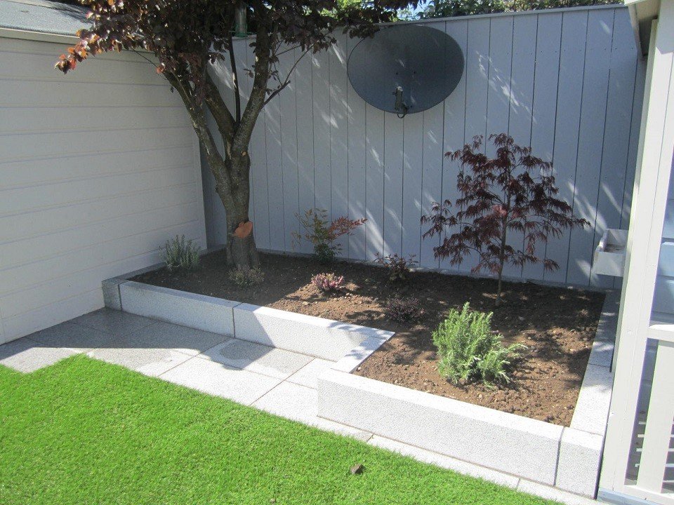 Raised back bed with paved area for seat