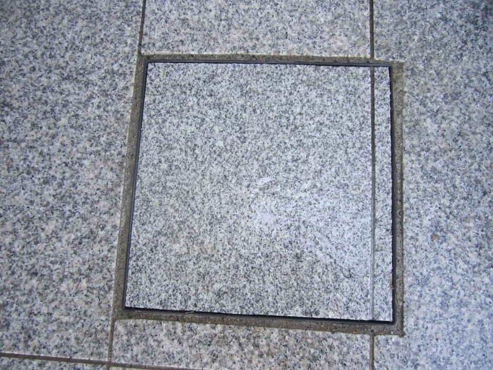 Disguised Man hole with grout line to match