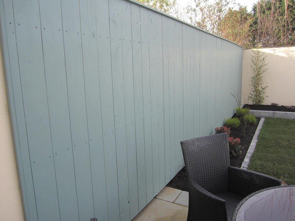 New fence clad to existing structure