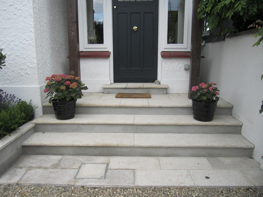 Side door, bullnosed steps framed with Hyydrangeas, also disguised man hole to the front