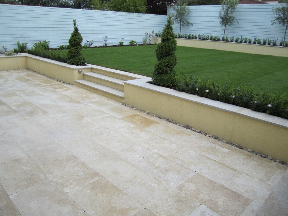 Raised lawn and Travatine patio